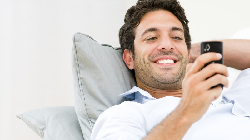 Image result for someone smiling at their phone